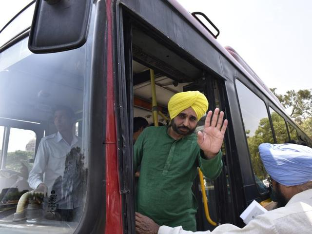 Aam Aadmi Party's Bhagwant Mann arrives in Parliament on a special bus for MPs.