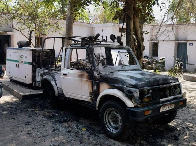 Students torched a jeep and several bikes after two youths were killed during clashes between two groups at the AMU campus.