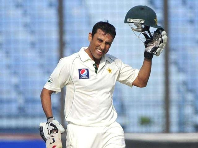 Pakistani batsman Younis Khan raises his helmet to acknowledge the crowd after scoring a century in a Test match against Bangladesh.