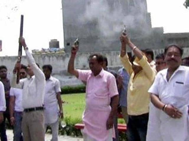 Shiv Sena leaders firing in the air during cremation of Durga Prasad Gupta in Khanna on Monday.