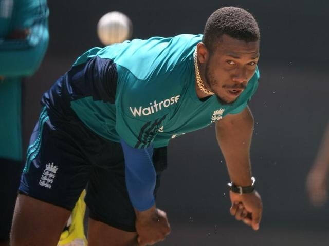 England's Chris Jordan celebrates with his teammate after taking the wicket of  Asghar Stanikzai.