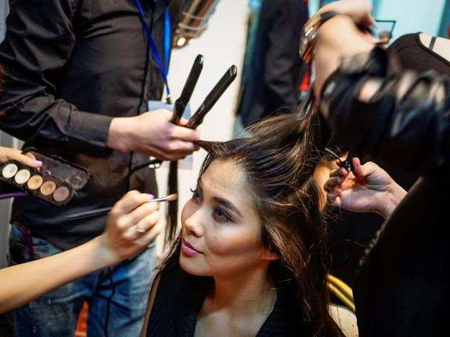 A model has her hair and make up done backstage during Kazakhstan Fashion Week in Almaty, Kazakhstan.