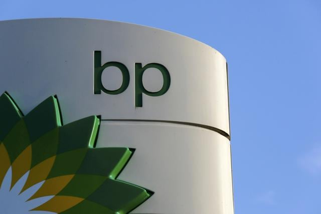 A BP logo is seen at a petrol station in London.