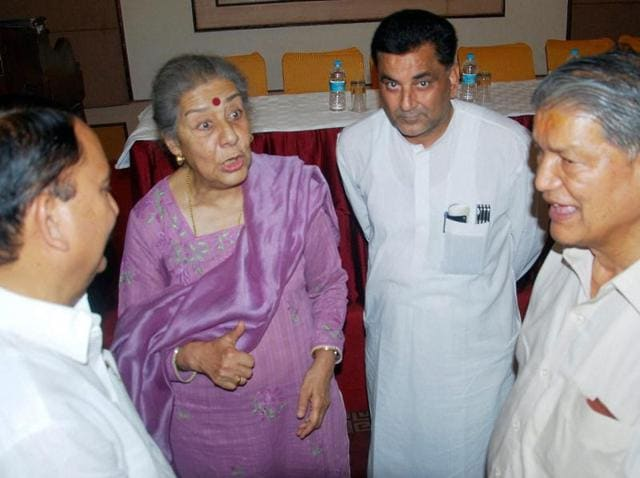 Former Uttarakhand CMHarish Rawat with state Congress in-charge Ambika Soni and Sanjay Kapoor (2R) during a meeting in Dehradun on Friday.