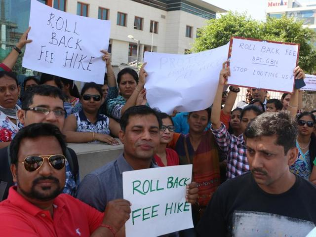 File photo of parents meeting Gautam Budh Nagar district magistrate NPSingh demanding rollback of fee hike in the twin cities of Noida and Greater Noida.