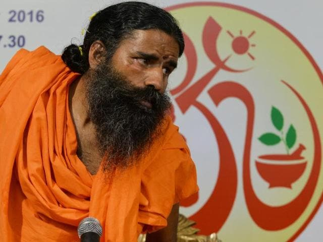 Yoga guru Ramdev said on Tuesday that he believes in non-violence and sought to play down his beheading remark.