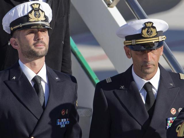 In this file photograph, Italian marines Massimiliano Latorre (R) and Salvatore Girone (L) arriving at Ciampino airport near Rome.