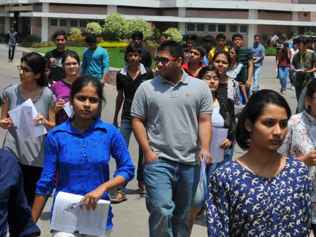 Students coming out of the examination centre after appearing in the JEE (Main) exam .