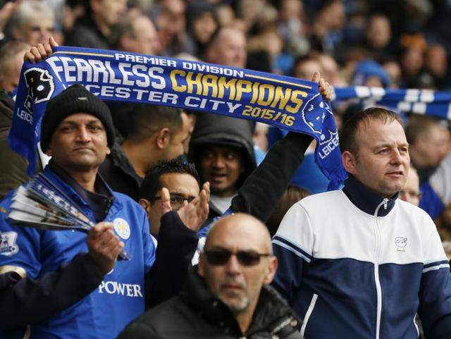 Leicester City fan holds up a scarf during their match against Swansea City.