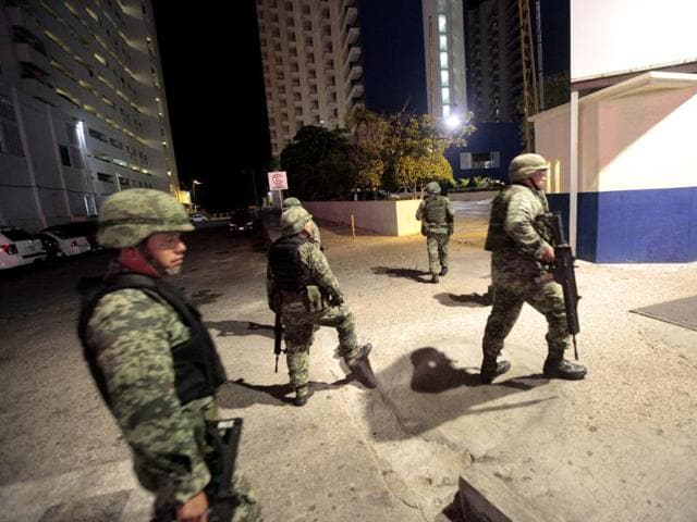 Mexican soldiers secure a tourist area after gunmen attacked a hotel where federal police stay in Acapulco.