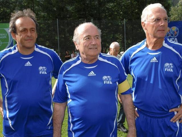 A file photo of FIFA President Sepp Blatter (C) UEFA President Michel Platini (L) and German soccer legend Franz Beckenbauer.