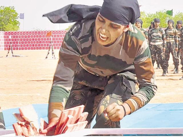 Female cadets of the Rajasthan Police Academy take part in a demonstration of martial art and self-defence techniques.