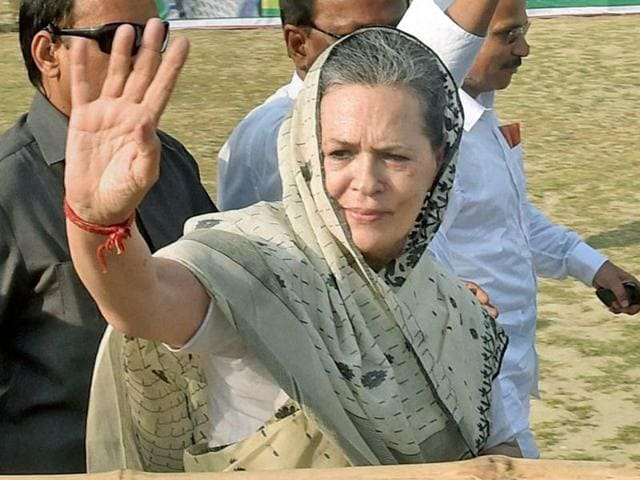 Congress president Sonia Gandhi waves to the crowd during an election campaign rally in South 24 Pargana on Tuesday.