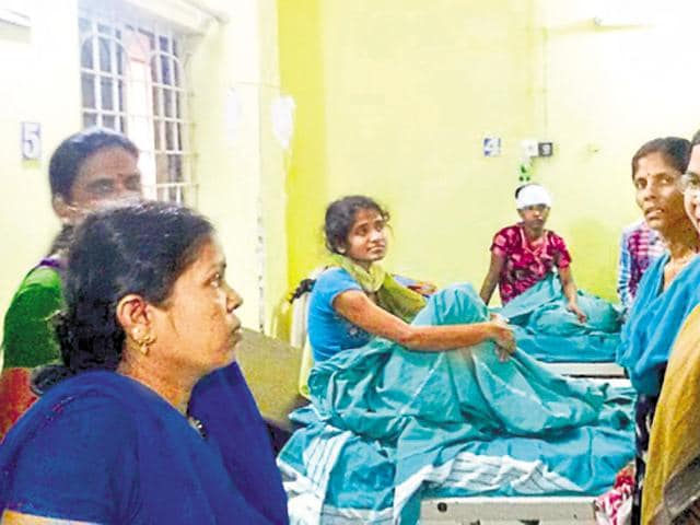 Varalakshmi (right), state general secretary of the CPI(M) and leader of the CITU, visiting the injured in a Bengaluru hospital.