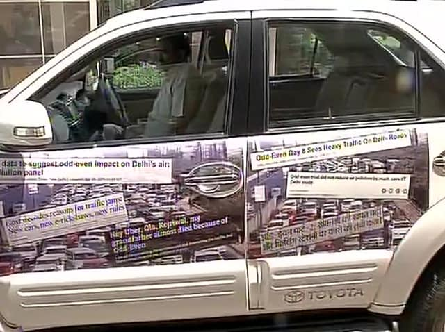 BJP MP Vijay Goel, drove to the Parliament in a car, with headlines about odd-even pasted on the vehicle's sides.
