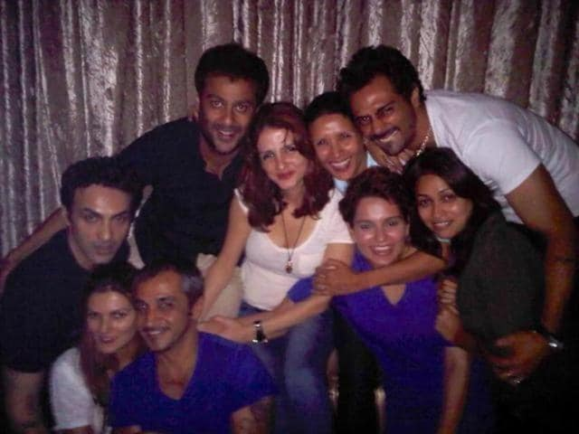 Another picture from the same party which shows Hrithik's ex-wife Sussanne Khan, filmmaker Abhishek Kapoor and actor Arjun Rampal , along with other guests posing for a group photo.