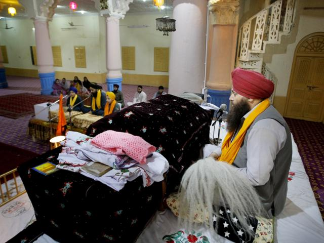 In this Sunday, April 24 photo, a Pakistani Sikh priest leads prayers at the 300-year-old gurdwara in Peshawar.