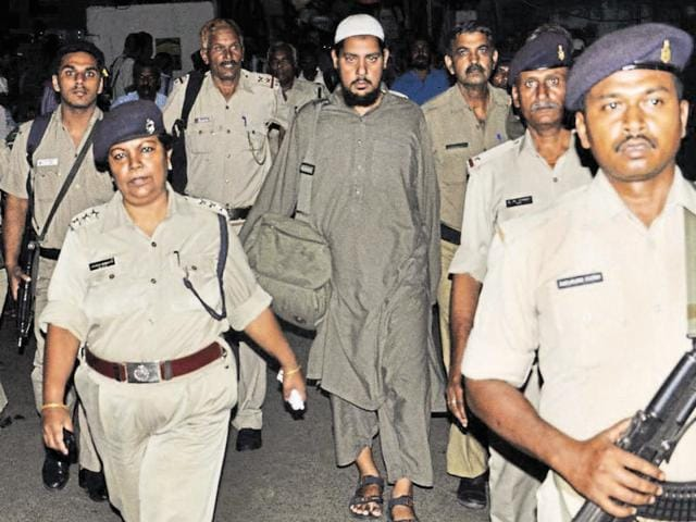 Police escort suspected al-Qaeda operative Abdul Rahman Katki after he was sent on a seven-day police remand by a Jamshedpur court on Tuesday.