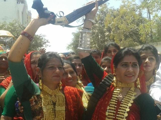 Images of women wearing bullet belts and carrying a double-barrelled shotgun at a religious celebration were widely shared, leading to police investigating the matter. Parading arms and celebratory firing are a mark of a person's importance and influence.