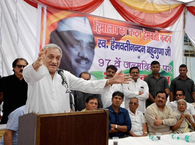 Vijay Bahuguna addresses a crowd on the 97th birth anniversary of his father, HN Bahuguna, in Dehradun..