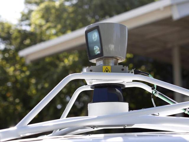 An Emirati gets off a ten-seater driverless car after a test run in Dubai on Tuesday. Dubai's ruler Sheikh Mohammed bin Rashid Al Maktoum has said a quarter of all trips in the commercial capital of the United Arab Emirates will be by driverless vehicles by 2030