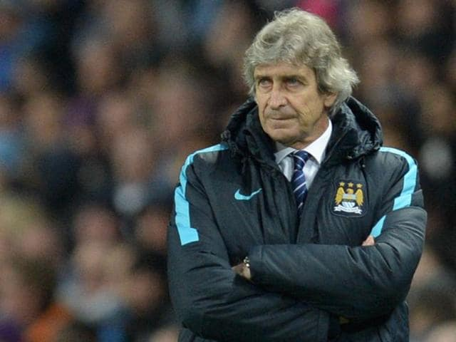 Manchester City's manager Manuel Pellegrini watches from the touchline during the Uefa Champions League semi-final first leg football match between Manchester City and Real Madrid.