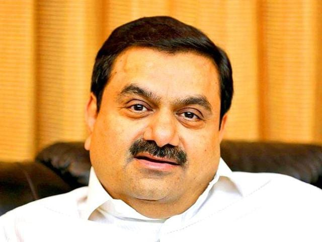 Gautam Adani signed a memorandum of understanding for a loan of up to $1 billion from the SBI for the mine, rail and port project in Queensland, which it aims to build by end-2017.