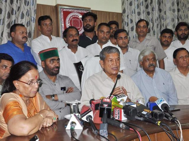 Deposed chief minister Harish Rawat addresses the media in Dehradun after Uttarakhand high court quashed the imposition of President's rule in the state.
