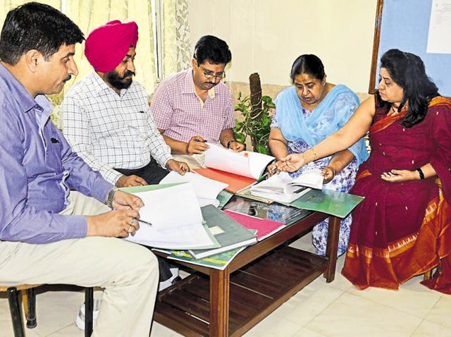 District science supervisor Sudeep Kaur (second from right) along with other education officials checking documents at Delhi Public School.