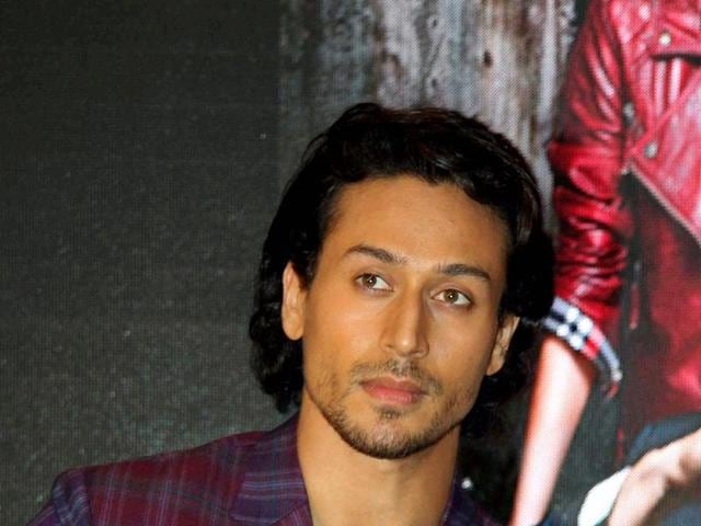 Indian Bollywood actors Tiger Shroff (L) and Shraddha Kapoor attend a promotional event for upcoming Hindi film 'Baaghi' in Mumbai on April 22, 2016.