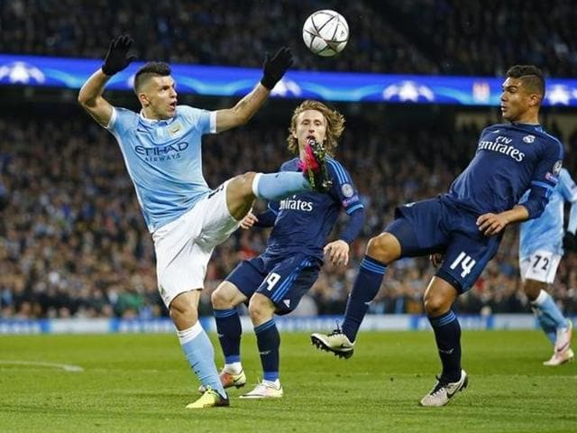Manchester City's Sergio Aguero in action with Real Madrid's Luka Modric and Casemiro.