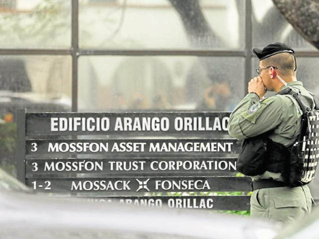 A police officer stands outside Mossack Fonseca law firm, in Panama City.