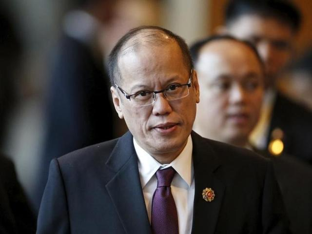 File photo of Philippine President Benigno Aquino arriving at a session of the Association of Southeast Asian Nations Summit in Kuala Lumpur, Malaysia, in November 2015.