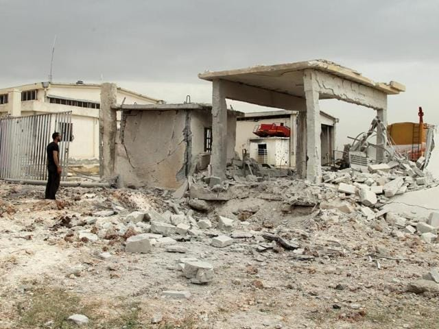 A damaged Civil Defence truck is pictured inside a rescue station in the rebel held town of Atareb, Aleppo countryside, Syria.