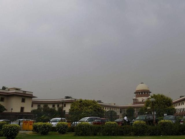 A view of the Supreme Court in New Delhi on Wednesday. The court said on Wednesday that a stay on the Uttarakhand high court order quashing President's Rule in the state will continue.