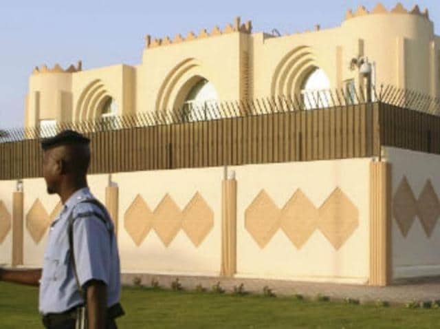 A policeman stands guard outside the Afghan Taliban office in Doha, Qatar.