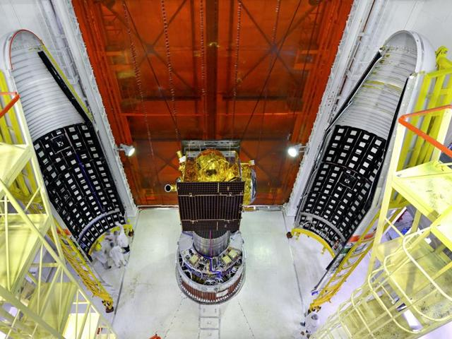 IRNSS-1G spacecraft integrated with PSLV-C33 with two halves of the heat shields seen.