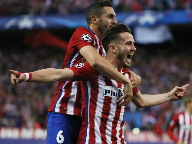 Saul Niguez celebrates with Koke after scoring the first goal for Atletico Madrid.