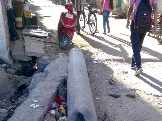Narmada pipeline being used as a bridge in Bhopal gas colony.