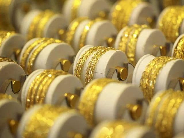 Gold jewellery is displayed in a shop.(HT File Photo)