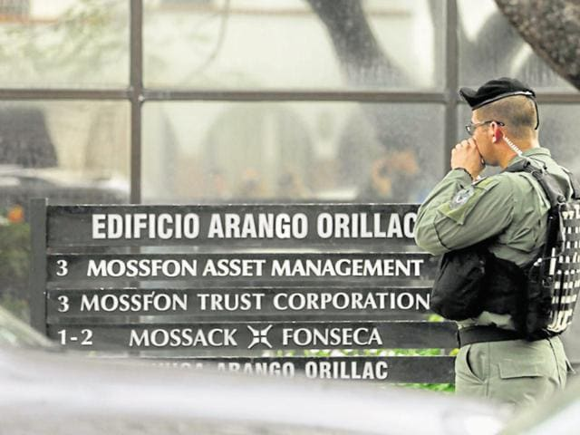 A police stand outside Mossack Fonseca law firm while Organized crime prosecutors raid the offices, in Panama City.