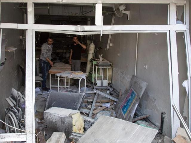 Syrians inspect the damage at the al Quds hospital building following reported airstrikes on the rebel-held neighbourhood of Sukkari in the northern city of Aleppo.