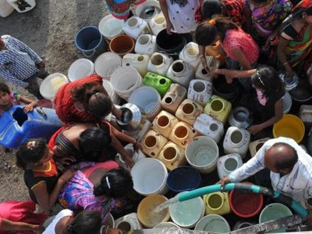 People line up their empty vessels around water tanker in Asha Colony in Khajrana area in Indore.