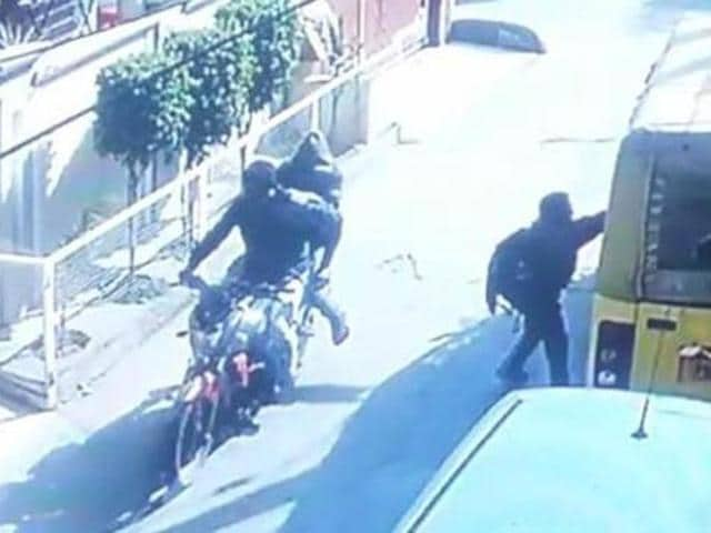 The footage of a CCTV camera installed outside a nearby house had showed two men with hoods on their heads, riding a Yamaha FZ silver-red bike, stopping for a few seconds (2.41pm) near a park, probably near Deepak, who is not visible though.