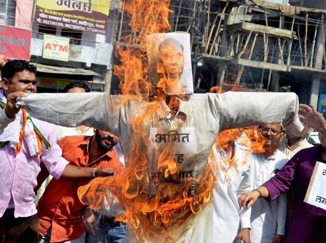 Madhya Pradesh Congress workers burn effigy of BJP president Amit Shah in Bhopal on Friday for his remarks on party president Sonia Gandhi in connection with AgustaWestland purchase.