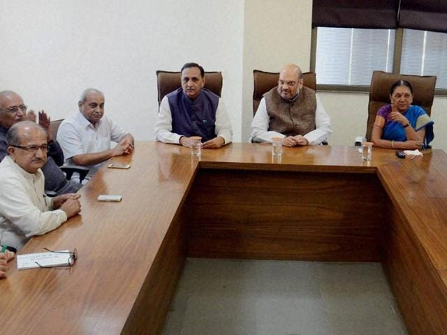 BJP president Amit Shah (centre), with CM Anandiben Patel  to his left and Gujarat BJP chief Vijay Rupani to his right, attends a party meeting in Gandhinagar on Friday.