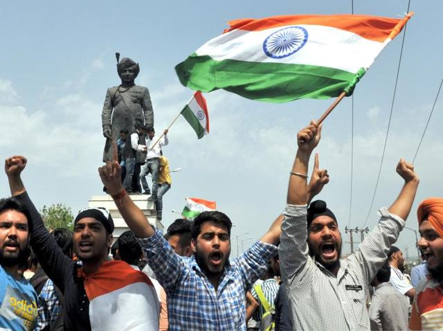 University students holding national flag in Jammu during a protest against unrest at the National Institute of Technology (NIT) of Srinagar on April 7, 2016