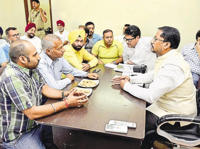 Representatives of the parents' association sharing their grievances with Punjab local bodies minister Anil Joshi (extreme right) at his office in Amritsar on Thursday.