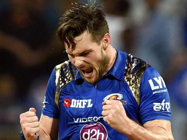Mumbai Indians bowler Mitchell McClenaghan (L) celebrates with captain Rohit Sharma.