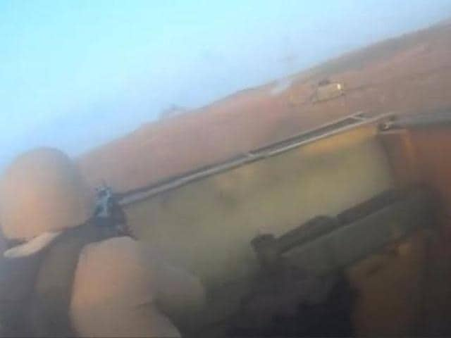 Islamic State fighters are seen inside a vehicle in Iraq, in this still image taken from an amateur video supplied by Kurdish Peshmerga and received by Reuters.